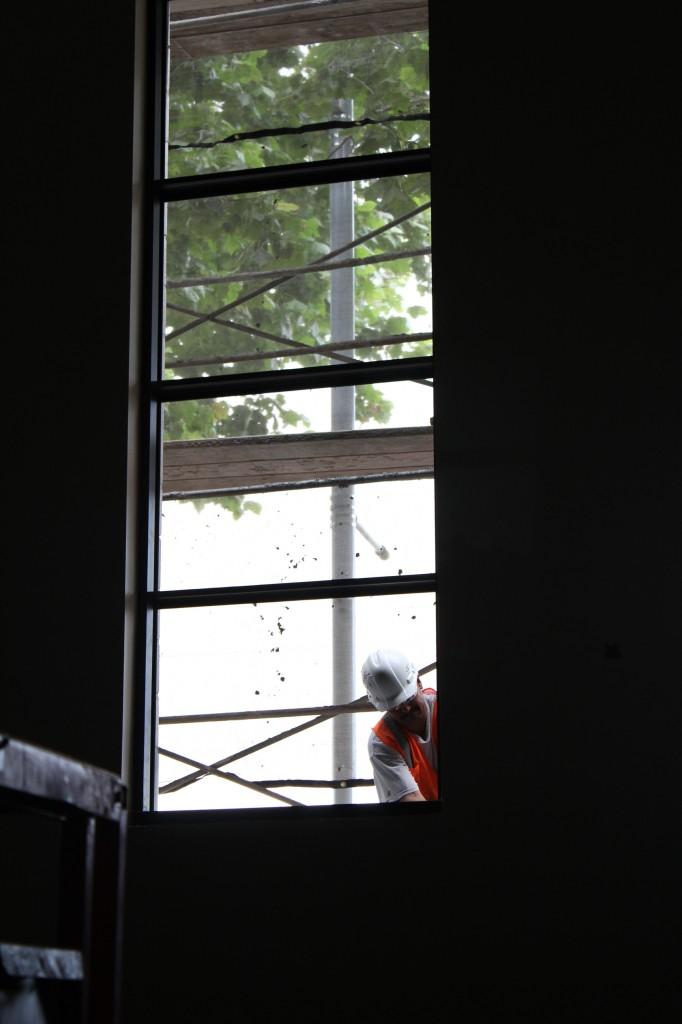 glazier at sanctuary window