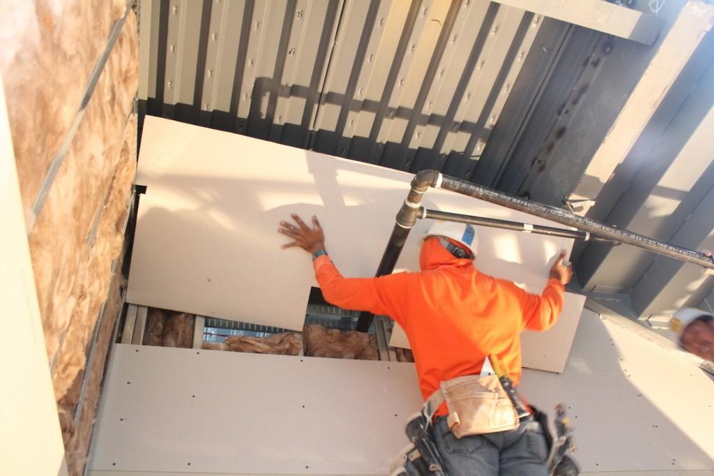 sheetrocking third floor entryway